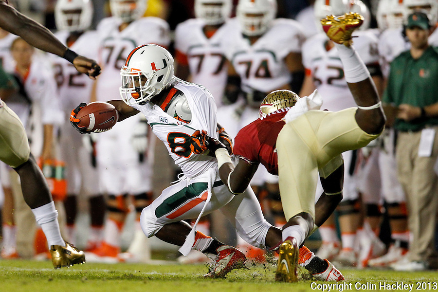TALLAHASSEE, FL 11/2/13-FSU-MIAMI110213CH-Florida State's P.J. Williams pulls down Miami's Duke Johnson during first half action Saturday at Doak Campbell Stadium in Tallahassee. <br /> COLIN HACKLEY PHOTO
