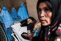 An Afghan woman on the bed was forced to get married and this is the reason of her suicide /Felix Features