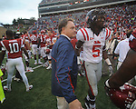 Ole Miss coach Houston Nutt walks off the field following the game vs. Arkansas at Reynolds Razorback Stadium in Fayetteville, Ark. on Saturday, October 23, 2010. Arkansas won 38-24.