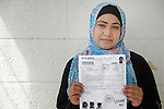 Ruba Abu Humaid, a refugee from Damascus, Syria, holds her family's United Nations-issued refugee registration documents in Amman, Jordan. Humaid, who is not allowed to work in Jordan, has received support from International Orthodox Christian Charities, a member of the ACT Alliance. (Note: details on the document have been blurred to protect privacy.)