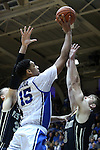 30 November 2014: Duke's Jahlil Okafor (15) shoots over Army's Larry Toomey (right). The Duke University Blue Devils hosted the West Point Military Academy Army Black Knights at Cameron Indoor Stadium in Durham, North Carolina in a 2014-16 NCAA Men's Basketball Division I game. Duke won the game 93-73.