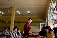 A waitress serves customers at a cafe in Batumi...
