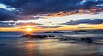 The setting sun over the Stockton Beach sand dunes in Port Stephens, NSW Australia