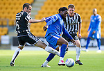 St Johnstone v St Mirren...11.09.10  .Collin Samuel is pulled back by John Potter.Picture by Graeme Hart..Copyright Perthshire Picture Agency.Tel: 01738 623350  Mobile: 07990 594431