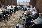 Palestinian ministers of unity government in Gaza Strip meet with members from the various Palestinian factions, at the headquarters of the Council of Ministers, in Gaza City on June 30, 2014. Photo by Mohammed Asad