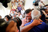 """Soum Rithy (C), who lost his father and three brothers during Khmer Rouge regime breaks in tears and hugs another survivor after the verdict was delivered in the trial of former Khmer Rouge head of state Khieu Samphan and former Khmer Rouge leader ''Brother Number Two'' Nuon Chea at the Extraordinary Chambers in the Courts of Cambodia (ECCC) on the outskirts Phnom Penh August 7, 2014. A U.N.-backed war crimes tribunal in Cambodia sentenced the two top surviving cadres of the Khmer Rouge regime to life in jail on Thursday after finding them guilty of crimes against humanity for their roles in the 1970s """"killing fields"""" revolution.   REUTERS/Damir Sagolj (CAMBODIA)"""