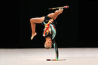 Maria Ringinen of Finland performs toss with clubs at World Games from Duisburg, Germany on July 21, 2005.  Event finals in rhythmic gymnastics are only held at World Games. (Photo by Tom Theobald)