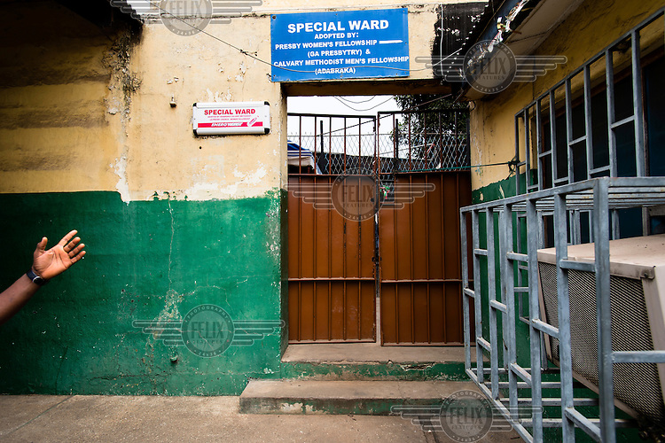 The entrance to the Special Ward at the Accra Psychiatric Hospital in Accra. According to a staff member, the ward was formerly known as the Murder Ward, and housed solely patients who had been convicted of killings. As there were few such patients and space was in demand, the ward now also accommodates patients suffering from psychiatric problems arising from hard drug abuse.