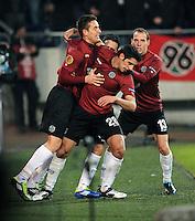 FUSSBALL   EUROPA LEAGUE   SAISON 2011/2012  SECHZEHNTELFINALE Hannover 96 - FC Bruegge                                    16.02.2012 Artur Sobiech, Lars Stindl und Jan Schlaudraff (v.l., alle Hannover 96) jubeln nach dem 1:1