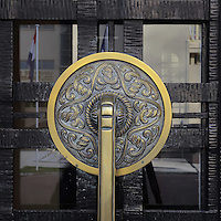 Door handle on the double doors at the main entrance to the Fondation des Etudiants Armeniens, designed by Leon Nafilyan, 1877-1937, in Armenian style and inaugurated in 1930, in the Cite Internationale Universitaire de Paris, in the 14th arrondissement of Paris, France. The CIUP or Cite U was founded in 1925 after the First World War by Andre Honnorat and Emile Deutsch de la Meurthe to create a place of cooperation and peace amongst students and researchers from around the world. It consists of 5,800 rooms in 40 residences, accepting another 12,000 student residents each year. Picture by Manuel Cohen