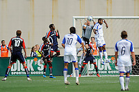 New England Revolution goalkeeper Matt Reis (1) grabs a ball as Rauwshan McKenzie (13) of the Kansas City Wizards goes up for a header. The New England Revolution and the Kansas City Wizards played to a 0-0 tie during an MLS regular season match at Gillette Stadium in Foxborough, MA, on July 11, 2009.