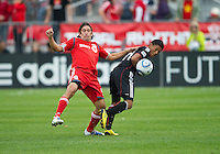 August 21 2010   D.C. United midfielder Andy Najar #14 and Toronto FC defender Nick Garcia #4 in action during a game between DC United and Toronto FC at BMO Field in Toronto..DC United won 1-0.
