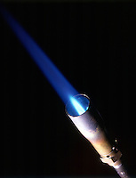 PROPANE FLAME<br /> C3H8 Burns In Air Producing A Blue Flame<br /> Propane is a liquid at 25' C under high pressure. When liquid propane is released from its storage tank, the pressure on it is lower and it changes to a gas.
