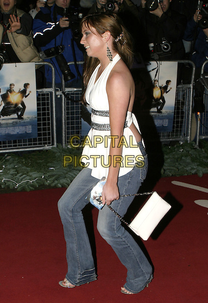 """BROOKE KINSELLA.Lemony Snicket's """"A Series of Unfortunate Events"""" film premiere, Empire cinema, Leicester Square,.London, 16th December 2004..full length brunette white silver halterneck top jeans.Ref: AH.www.capitalpictures.com.sales@capitalpictures.com.©Capital Pictures..."""