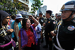 A woman demonstrator pleads with police as displaced residents of Boeung Lake in Phnom Penh, who were left homeless after the government allowed a private developer to move them out and fill in the lake, attempt to protest in the Cambodian capital on December 10, 2012. They planned to take their protest to the prime minister's office, but police stopped them far short of their goal. Their protest took place on International Human Rights Day.