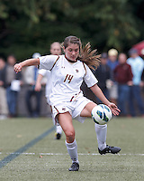 Boston College defender Madison Meehan (14) passes the ball.   University of North Carolina (blue) defeated Boston College (white), 1-0, at Newton Campus Field, on October 13, 2013.