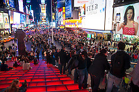 Times Square panorama from the height of red stairs of Duffy Square, NEW York City, USA