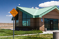 "A sign in a Utah desert rest area warns, ""Watch for SNAKES & SCORPIONS"".  On the building, between Salt Lake City and the Bonneville Salt Flats, is another sign, ""Welcome to the Grassy Mountain East Rest Area""."