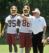 Ashburn, VA - June 11, 2008 -- Washington Redskins tight ends coach Rennie Simmons, right, instructs tight ends Fred Davis (86), center, and Jason Goode (85), left during an organized team activity (OTA) as part of their preparations for the 2008 National Football League season at their training facility, Redskins Park in Ashburn, Virginia on Wednesday, June 11, 2008..Credit: Ron Sachs / CNP