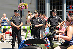 Local Police Officers on duty during the Saugerties July 4th Parade on Main Street in Saugerties, NY on Monday, July 4, 2011. Photo by Jim Peppler. Copyright © Jim Peppler 2011.