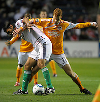 Houston defender Andrew Hainault (31) battles with Chicago defender Wilman Conde (22).  The Chicago Fire defeated the Houston Dynamo 2-0 at Toyota Park in Bridgeview, IL on April 24, 2010.