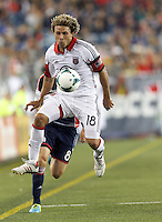 D.C. United midfielder Nick DeLeon (18) collects a pass.  In a Major League Soccer (MLS) match, the New England Revolution (blue) defeated D.C. United (white), 2-1, at Gillette Stadium on September 21, 2013.
