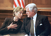 First lady Hillary Rodham Clinton and United States Senator Edward M. &quot;Ted&quot; Kennedy (Democrat of Massachusetts) talk to one another during a Capitol Hill press conference on September 28, 1999 in Washington, DC.  The press conference was called to discuss a new study by the Economic Policy Institute on the impact a minimum-wage increase would have on working women.  Both favor the increase.<br /> Credit: Ron Sachs / CNP