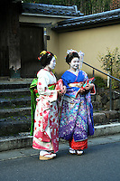 "Geisha on the streets of Arashiyama - geiko as they are called in Kyoto, are traditionally entertainers whose skills include performing various Japanese arts such as classical music and dance. Apprentice geisha are called maiko literally ""dance child""."