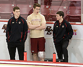 Stephen Greenberg (BC - Senior Manager), Kevin Hayes (BC - 12) and Chris Malloy (BC - Student Manager) watch warmups from the Eagles bench. - The Boston College Eagles defeated the visiting University of Maine Black Bears 4-1 on Sunday, November 21, 2010, at Conte Forum in Chestnut Hill, Massachusetts.