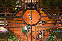 """A top-down look at Orange Coast College's Ornamental Horticulture Club's in-progress installation at the 2012 South Coast Plaza Spring Garden Show in Costa Mesa, CA.  The theme for this year's show is """"healing gardens"""", and the OCC team is installing a """"garden for the blind,"""" which will be complete with a braille world globe and braille labels.  This picture was taken Tuesday April 25, 2012 at ~11pm, as the team was working frantically to meet their Thursday-morning deadline."""