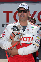 LOS ANGELES - APR 3:  Eddie Cibrian with dog who is a trained assistant to a hearing impared woman, hence, the ear covers to protect his hearing (the dog) at the 2012 Toyota Pro/Celeb Race Press Day at Toyota Long Beach Grand Prix Track on April 3, 2012 in Long Beach, CA