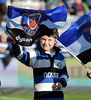 A young Bath fan waves a flag in support. Aviva Premiership match, between Bath Rugby and Harlequins on October 31, 2015 at the Recreation Ground in Bath, England. Photo by: Alex Davidson / JMP for Onside Images