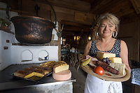Ramsau am Dachstein, Steiermark, Styria, Austria, September 2008. The farmer at the Walcher Alm Senn Hut, shows us all of her delicious food. The hams, cheeses, bacon and patries are home made. The province of Styria is known for its green alpine landscape, good food and many lakes. Photo by Frits Meyst/Adventure4ever.com