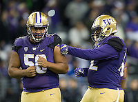 Vita Vea (50) and Jaylen Johnson goof around during a timeout after the game is out of hand.