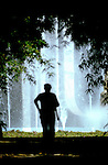 Silhouetted man against a fountain of water in parque Garcia Sanbria.Santa Cruz de Tenerife. Tenerife. Tenerife, Canary Islands,Spain