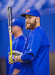 4 April 2015: Toronto Blue Jays catcher Russell Martin awaits his turn in the batting cage prior to an exhibition game against the Cincinnati Reds at Olympic Stadium in Montreal, Quebec, Canada. The Blue Jays defeated the Reds 9-1 in the second of two MLB weekend exhibition games. Mandatory Credit: Ed Wolfstein Photo *** RAW (NEF) Image File Available ***