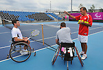 LONDON, ENGLAND – 08/24/2012: Christian Gingras coaching Joel Dembe and Philippe Bedard during a training session at the London 2012 Paralympic Games at Eton Manor. (Photo by Matthew Murnaghan/Canadian Paralympic Committee)