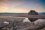 Idaho, West Central, New Meadows. Spring morning with barn reflected in a small pond.
