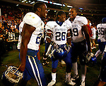 UK Touch back CoShik Williams and other Kentucky players celebrate their 34-27 win over the University of Georgia Bulldogs on Saturday, Nov. 21, 2009 at Sanford Stadium in Athens, Ga.