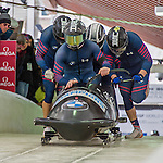 9 January 2016: United States of America pilot Codie Bascue leads his 4-man team as they push off their first run of the day at the BMW IBSF World Cup Bobsled Championships at the Olympic Sports Track in Lake Placid, New York, USA. Bascue's team came in 15th for the day, with a 2-run combined time of 1:51.44. Mandatory Credit: Ed Wolfstein Photo *** RAW (NEF) Image File Available ***