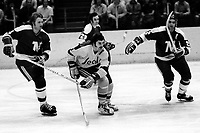 Seals Ivan Boldirev is flanked by North Stars Dennis Oliver and Barry Gibbs. (1975 Photo/Ron Riesterer)