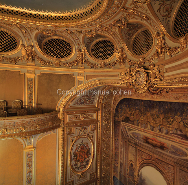 """High angle view showing a fragment of the ceiling, the grated boxes (loges grillées) located at the Gods or Paradise (paradis or poulailler in French), the first balcony and the Frons scaenae (stage wall) with trompe-l'oeil painting, Theatre Imperial Napoleon III de Fontainebleau (Fontainebleau Theatre Napoleon III), 1853-1856, by Hector Lefuel, Fontainebleau, Seine-et-Marne, France. Restoration of the theatre began in Spring 2013 thanks to an agreement between the Emirate of Abu Dhabi and the French Governement dedicating 5 M€ to the restoration.  In recognition of the sponsorship by the Emirate of Abu Dhabi, French Governement decided to rename the theatre as """"Theatre Cheikh Khalifa bin Zayed Al Nahyan"""" (Cheikh Khalifa bin Zayed Al Nahyan Theatre). The achievement of the first stage of renovation has allowed the opening of the theatre to the public on May 3, 2014. Picture by Manuel Cohen"""