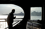 Passenger on ferry boat crossing the Bosphorus Sea in Istanbul Turkey