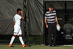 26 August 2016: Wake Forest's Jacori Hayes (8) indicates to head coach Bobby Muuss (right) which direction the team will be attacking in the first half. The Wake Forest University Demon Deacons hosted the Saint Louis University Billikens in a 2016 NCAA Division I Men's Soccer match. SLU won the game 1-0.