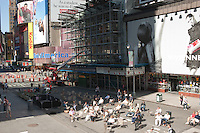 People in folding chairs on the street in Times Square, NY