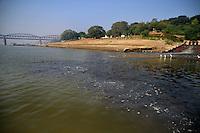 Methane foams is seen in the black sewage water entering the river Ganga in Varanasi, Uttar Pradesh, India.