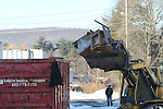 TORRINGTON, CT - 30 December, 2010 - 123010MO05 - Mountain Top Trucking workers removed debris, and a few artifacts on Thursday from Torrington's old train station, which will be demolished next week. Jim Moore photo.
