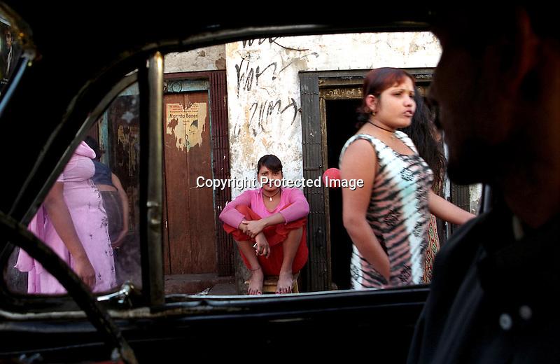 INDIA (West Bengal - Calcutta) -Sex workers waiting for customers at Munsigaunge red light area in Kolkata .- Arindam Mukherjee