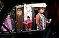 INDIA (West Bengal - Calcutta) -Sex workers waiting for customers at Munsigaunge red light area in Kolkata .- Arindam Mukherjee