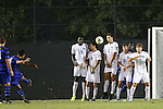 19 September 2014: Duke's Sean Davis (6, left) scores the tying goal on a free kick over a wall of UNC players: C.J. Odenigwe (22), Andy Craven (10), Jonathan Campbell (2), Rob Lovejoy (16), and Alan Winn (5). The Duke University Blue Devils hosted the University of North Carolina Tar Heels at Koskinen Stadium in Durham, North Carolina in a 2014 NCAA Division I Men's Soccer match. Duke won the game 2-1.